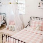 Bedroom, Black Iron Bed Platform, Pink Bedding, White Wall, White Curtain Tent, Brown Rug