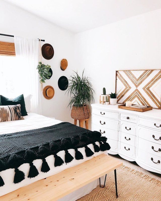 bedroom, bron rug, wooden bench, white wall, white cabinet, white curtain, wooden stool with plants