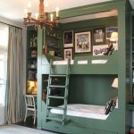 Bedroom, Dark Floor, Blue Rug, Green Wooden Bunk Bed With Drawer, Built In Shelves, Paintings, Shelves, Chandelier