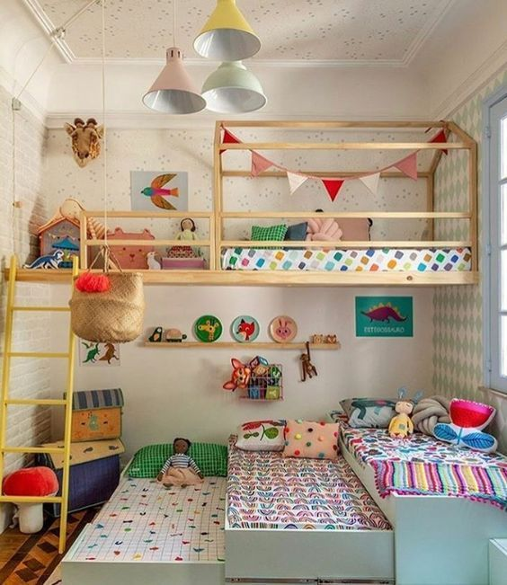 bedroom, three beds on the floor, one bed on top, wooden platform, toys, white pendants