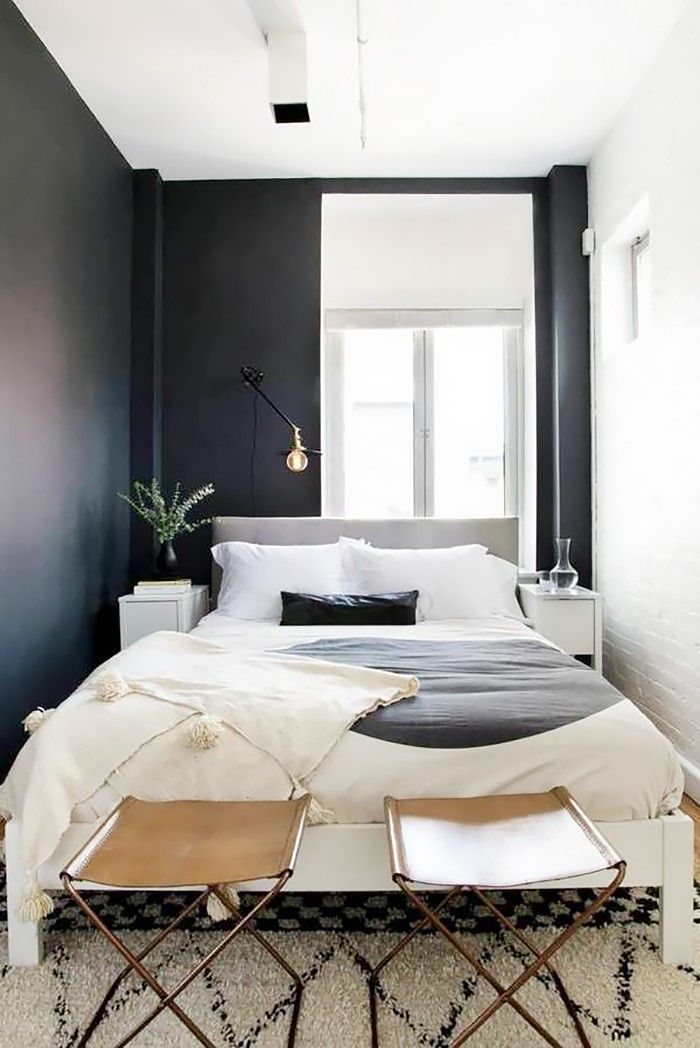 bedroom, wooden floor, black wall, white exposed wall, brown leather, white bed platform, white bedside table