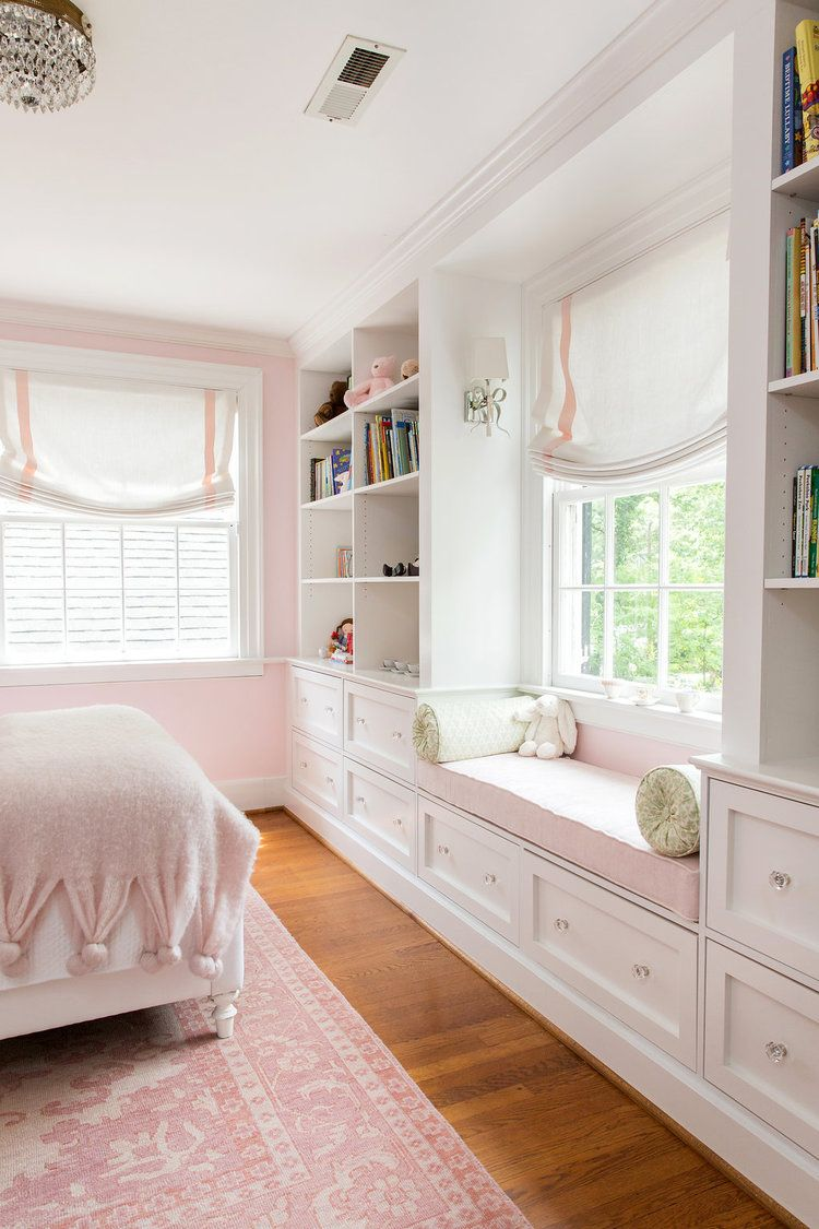 bedroom, wooden floor, white cabinet, white shelves, pink cushion, pink patterned rug, white bed platform, pink bedding, white curtain