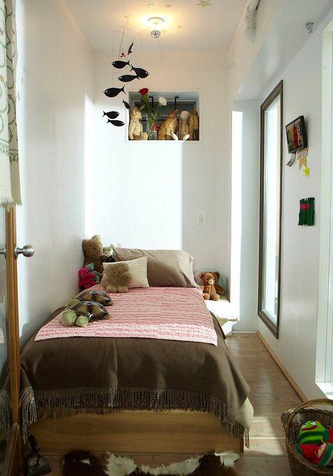 bedroom, wooden floor, white wall, indented shelves, tall glass window, wooden bed platform