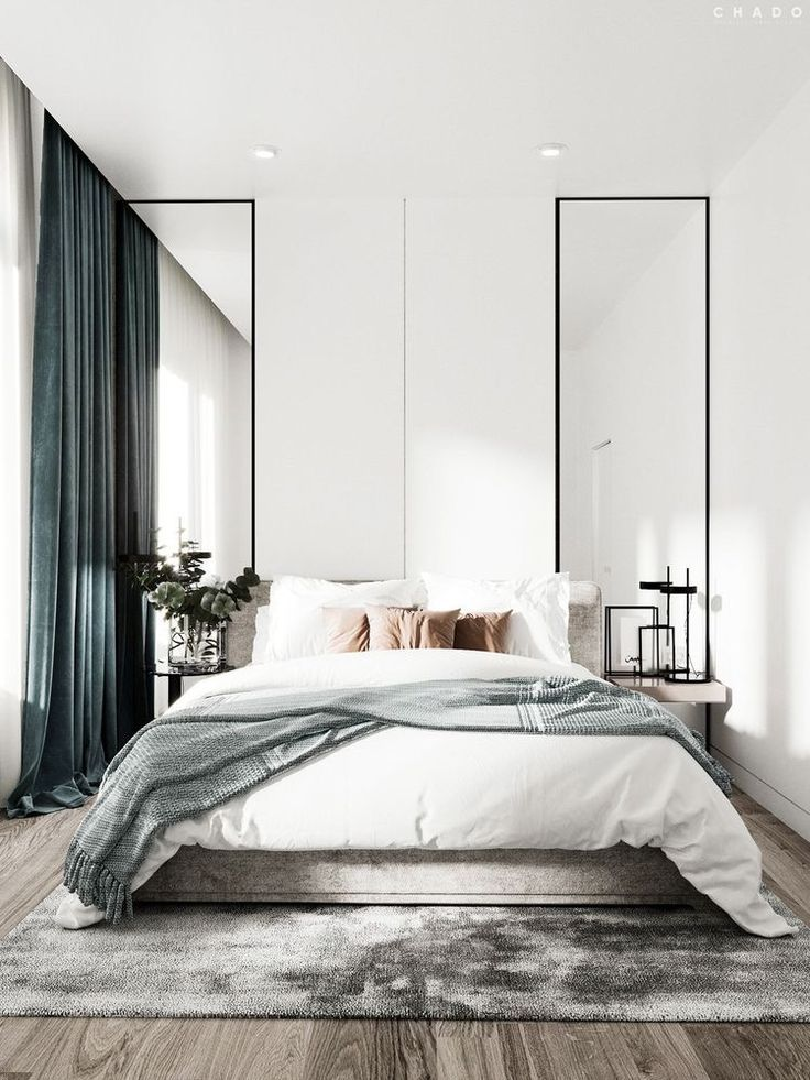 bedroom, wooden floor, white wall, tall mirrors, side table, light wooden bed platform, grey rug, ceiling lamp