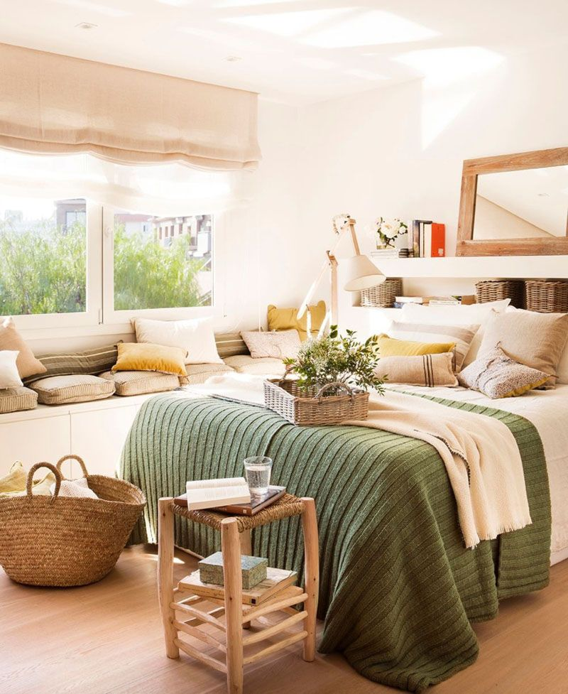 bedroom, wooden floor, white wall, white cabinet, cushions, pillows, white shelves headboard, wooden rattan side table, rattan bag,