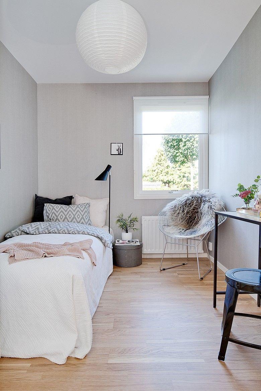 bedroom, wooden floor, white wall, white framed window, white round pendant, black table, stool, black floor lamp, relax chair