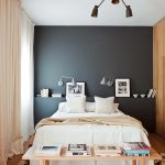 Bedroom, Wooden Floor, Wooden Wall, Black Accent, White Ceiling, Wooden Bench, Grey Sconces, Black Chandelier
