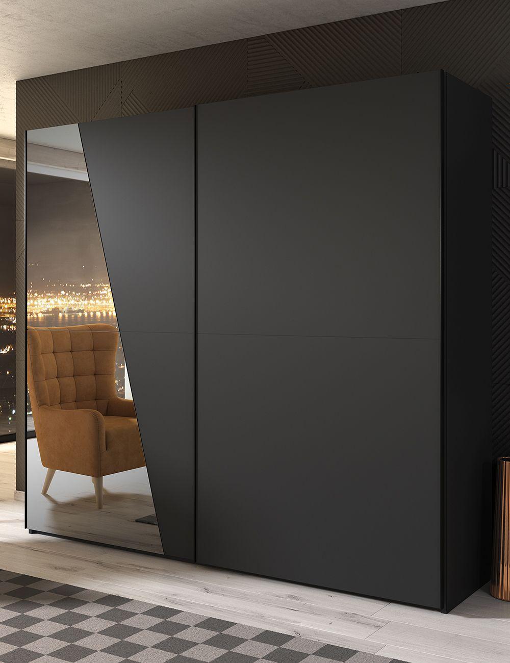 black cupboard, mirror, wooden floor, patterned rug