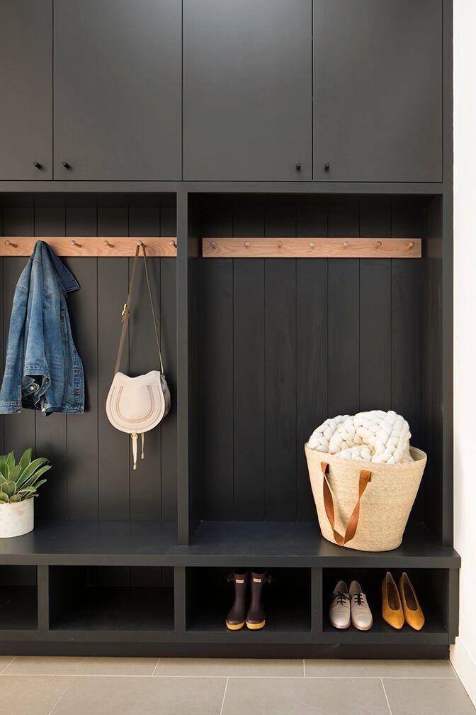 black entrance, black cabinet, black shelves, grey floor