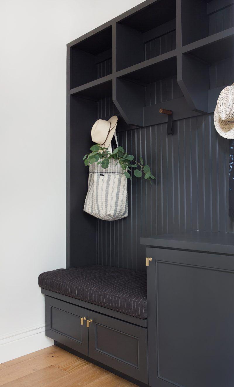 black entrance, black wall, black cabinet, hook