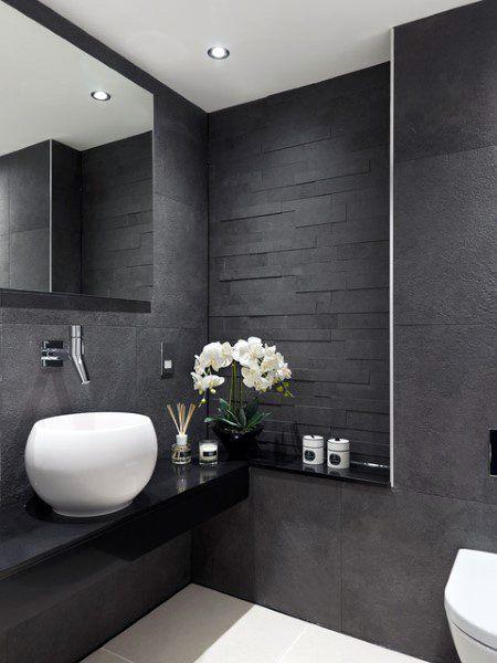 black vanity, black floating vanity, black wall, mirror, white bowl sink, white toilet, white floor
