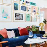 Blue Velvet Sofa, White Wall, Pictures, White Coffee Table, Wooden Chair, Golden Floor Lamp