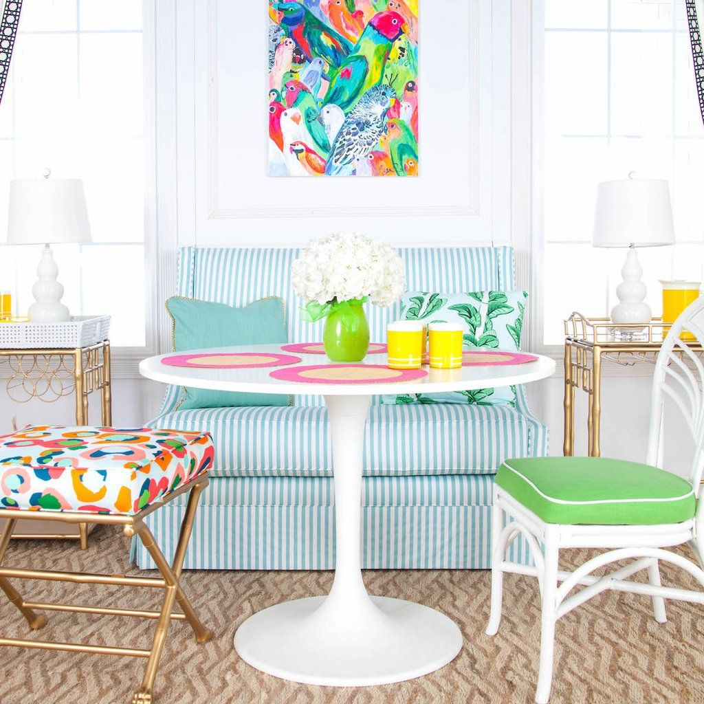 breakfast nook, white green striped sofa, colorful stool with golden legs, green cushioned stool, white pink tulip table
