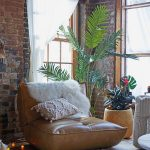 Brown Leather Lounge Chair, White Rug, Wooden Floor, Grey Rug, Brick Exposed Wall