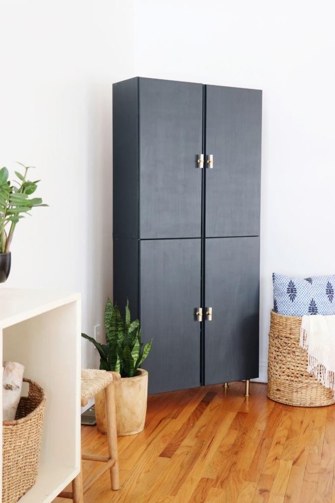 dark blue ivar cabinet stacked, wooden floor, white wall