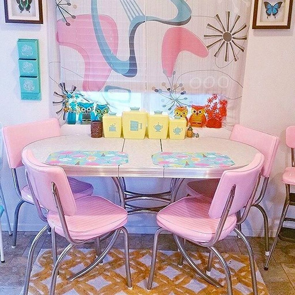 dining room, brown floor, yellow patterned rug, brown table, pink chairs, cream wall, patterned custain