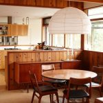 Dining Room, Brown Rug, Wooden Half Down Wall, Glass Window, Round Wooden Table, Wooden Chairs
