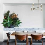 Dining Room, Dark Floor Tiles, Wooden Table, Wooden Chairs With Grey Cushion, White Wall, White Cabinet, Blue Marble Top