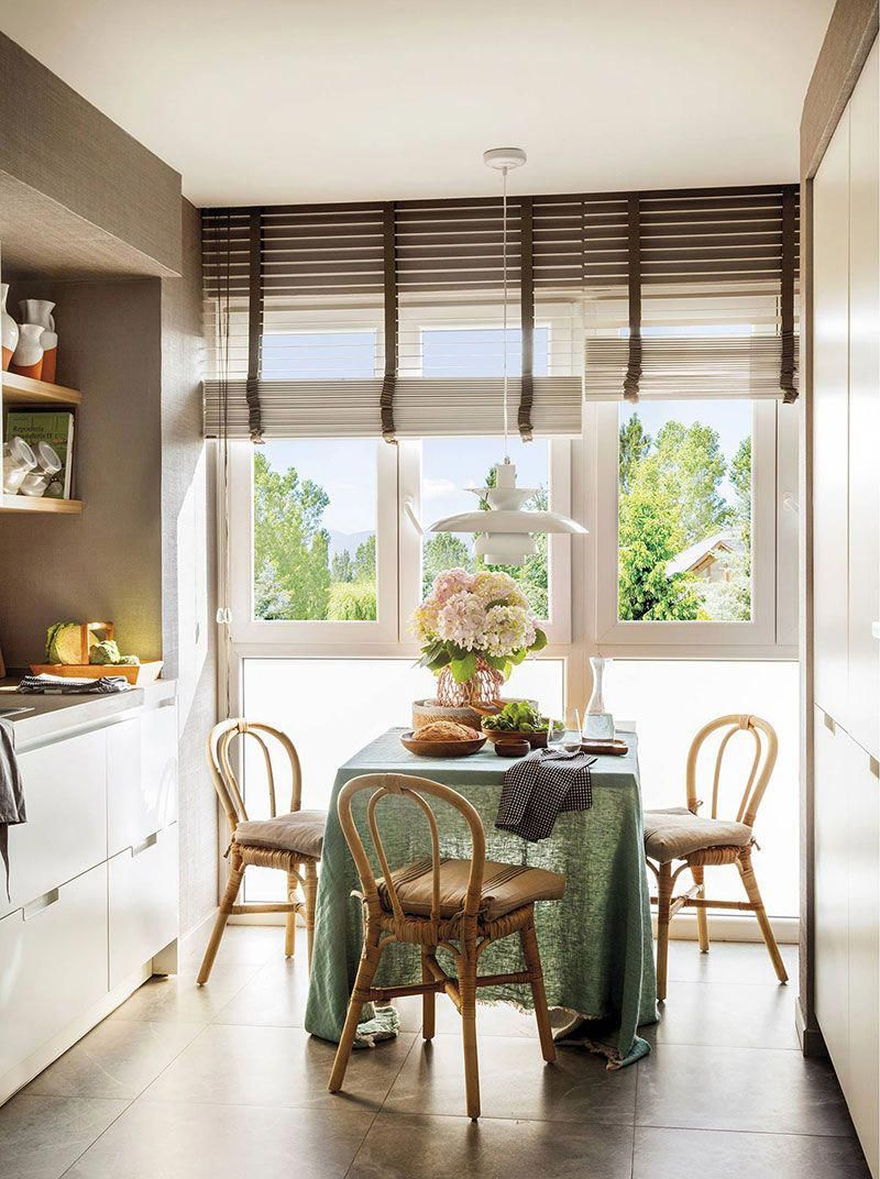 dining room, green tablecloth, rattan chairs, glass window, white modern cabinet