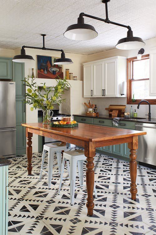 dining room, patterned floor, white wall, white top cabinet, green bottom cabinet, green cabinet, wooden table, white chairs, black pendants