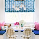 Dining Room, White Corner Bench With Blue Cushion, White Wall, White Bulb Chandelier, White Tulip Table, Golden Lined Chairs