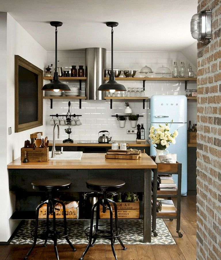 dining room, wooden floor, white subway wall, white wall, open shelves, grey bottom cabinet with wooden counter top, dark island with wooden top, black pendants