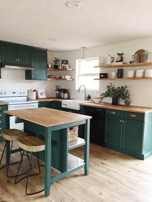 dining room, wooden floor, white wall, dark green cabinet, dark green island with wooden top, wooden kitchen counter top, wooden open shelves