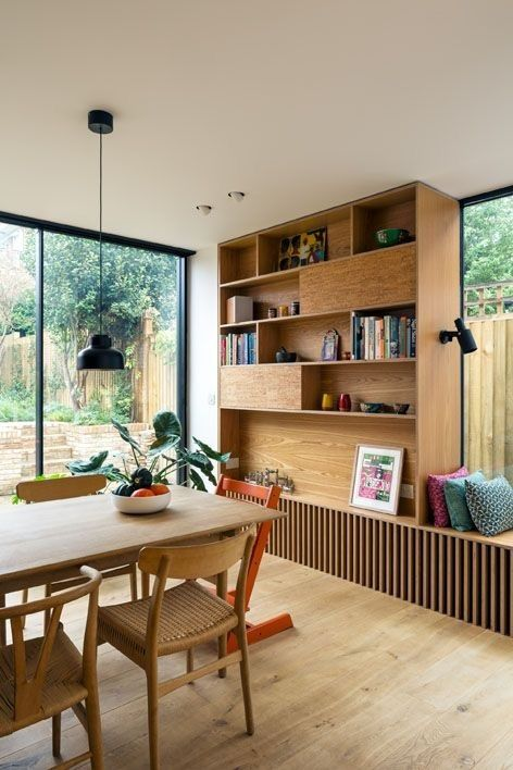 dining room, wooden floor, white wall, white ceiling, wooden window sill, wooden shelves, wooden dining table,
