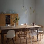 Dining Room, Wooden Floor, Wooden Dining Table, Wooden Chairs, White Modern Chair, Grey Wall, Wooden Cupboard, Glass Pendants