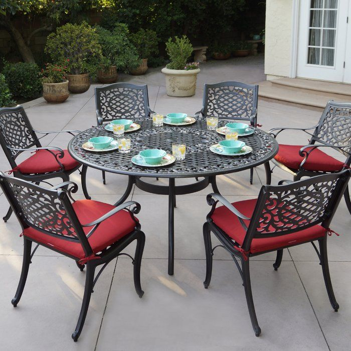 dining table, black iron chairs, black iron round table, red cushion