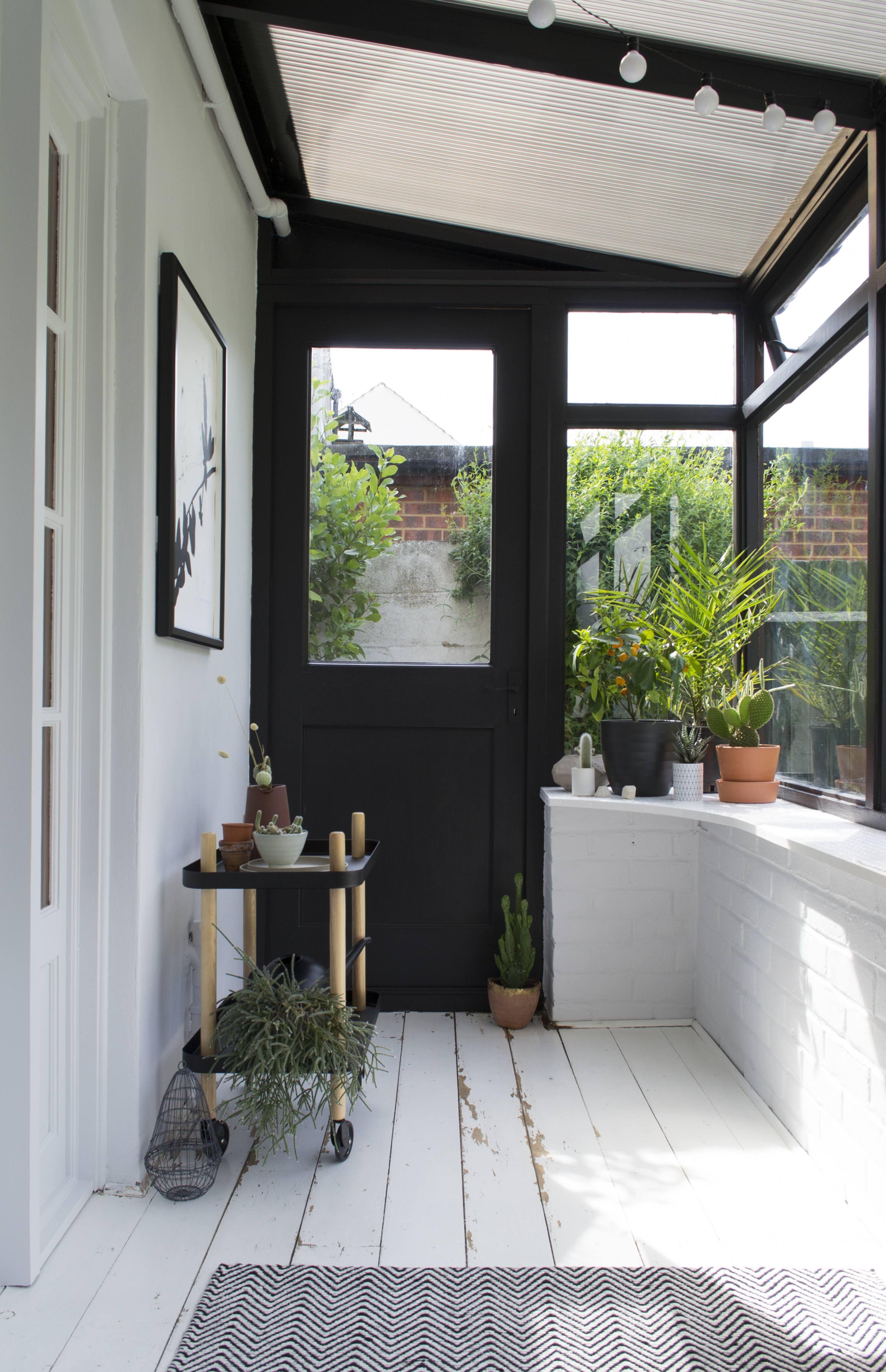 entrance, white wooden floor, white brick wall, black door, glass window