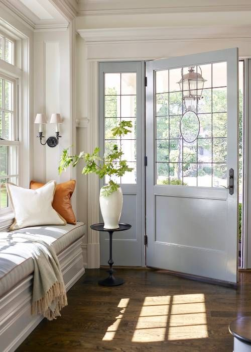 entrance, wooden floor, white bench, window bay, white door