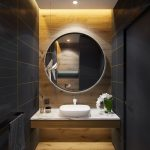 Floating Vanity With White Marble Top, White Sink, Wooden Accent Wall And Floor, Black Wall With Golden Lines, Round Mirror