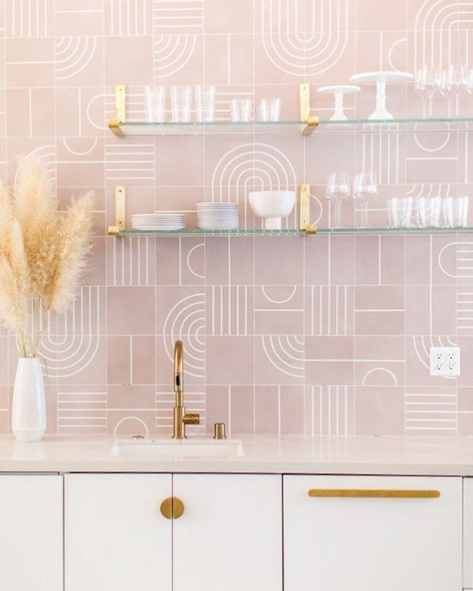 glass floating shelves, pink patterned wall, golden lines