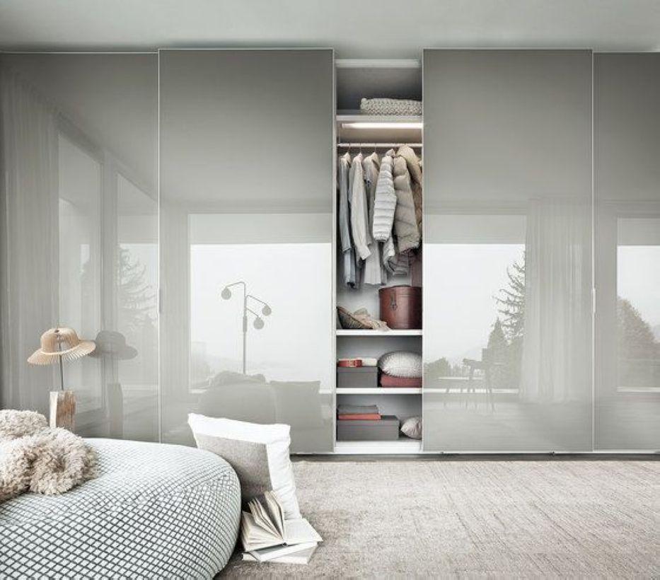 gloss white wardrobe, shelves, grey round ottoman