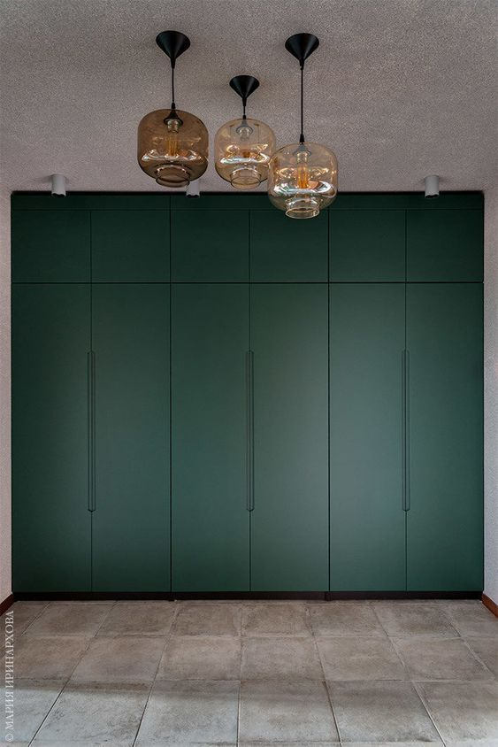green smooth cabinet, grey floor, concrete wall, glass pendants