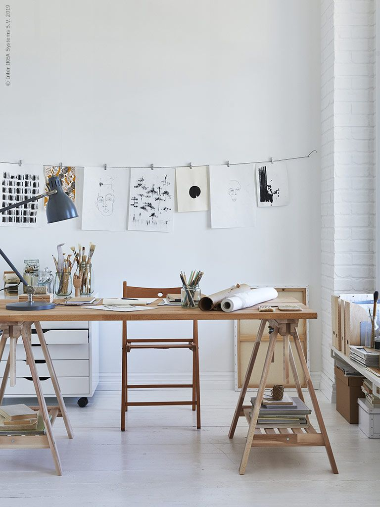 home office, white floor, white wall, white exposed wall, wooden table, wooden chair, floor shelves