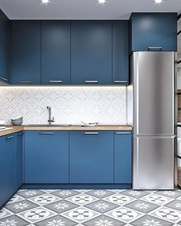 kitchen, blue cabinet, white backsplash, patterned floor, silver, wooden counter top