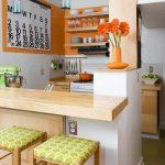 Kitchen, Brown Floor, White Wall, Orange Wall, Wooden Counter Top, Wooden Island Bar, Green Stools, Open Shelves