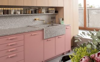 kitchen, grey floor, wooden cabinet, pink bottom cabinet, grey marble counter top, black chairs, green table