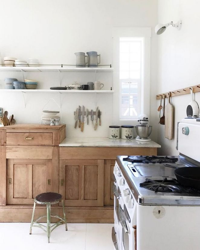 kitchen, white floor tiles, white wall, wooden kitchen cabinet with white marble top, white floating shelves