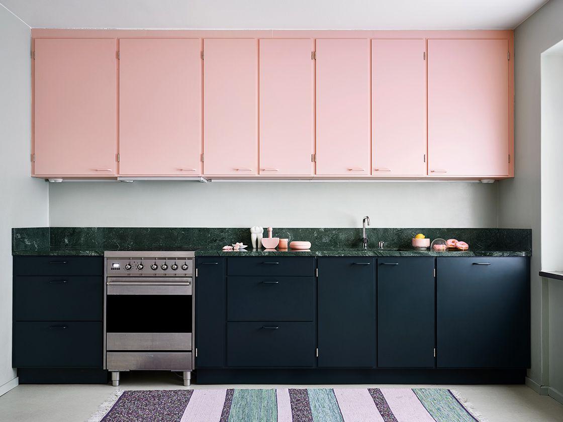 kitchen, white floor, white wall, black bottom cabinet, pink top cabinet, green backsplash