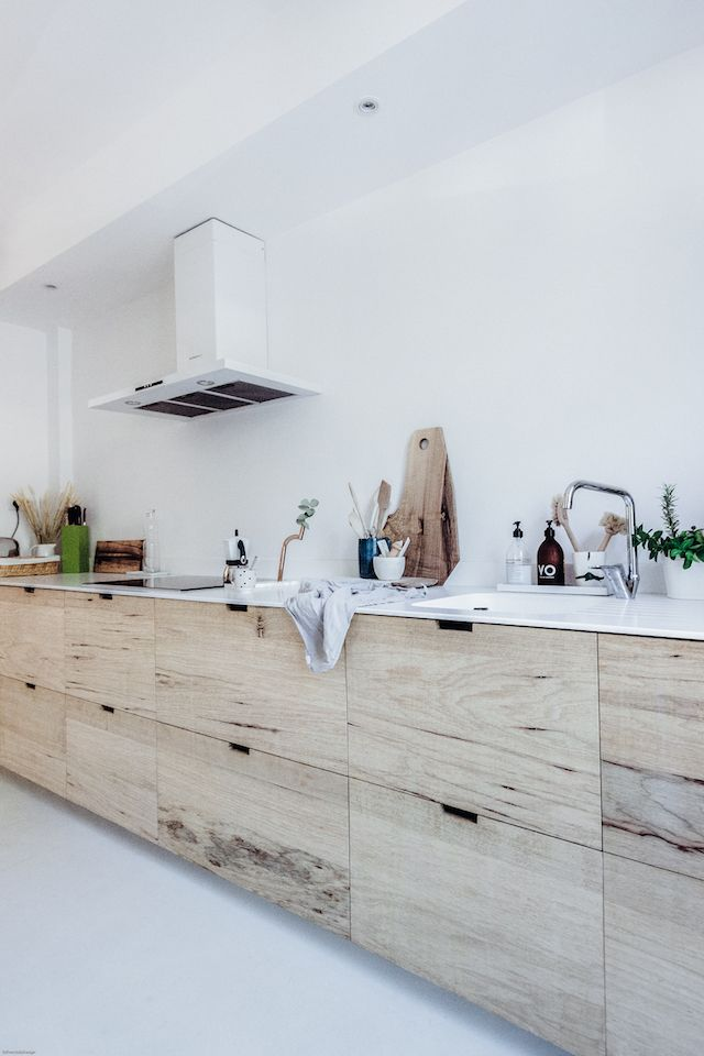 kitchen, white floor, white wall, wooden cabinet with white top