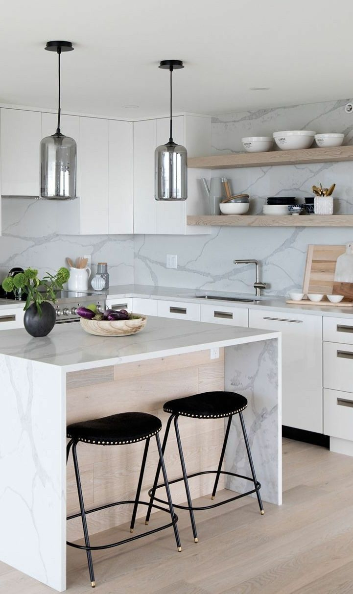 kitchen, white marble wall, white top cabinet, silver pendants, wooden open shelves, marble island, black stools
