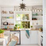 Kitchen, White Wooden Floor, White Wall, White Wooden Ceiling, White Cabinet, White Floating Shelves, White Framed Window, Wooden Counter Top, Rattan Chair And Rug