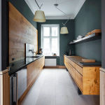 Kitchen, Wooden Floor, Green Wall, Wooden Board On The Wall, Long Wooden Cabinet, Black Floating Shelves