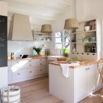 Kitchen, Wooden Floor, White Cabinet, White Subway Backsplash, Wooden Counter Top, White Indented Shelves, Rattan Pendants