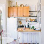 Kitchen, Wooden Floor, White Island, White Wall, Wooden Cabinet, Open Shelves, Black Ceiling Fan