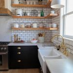 Kitchen, Wooden Floor, White Subway Floor, Black Cabinet With White Marble Top, White Apron Sink, Wooden Open Shelves, White Pendant, Golden Faucet