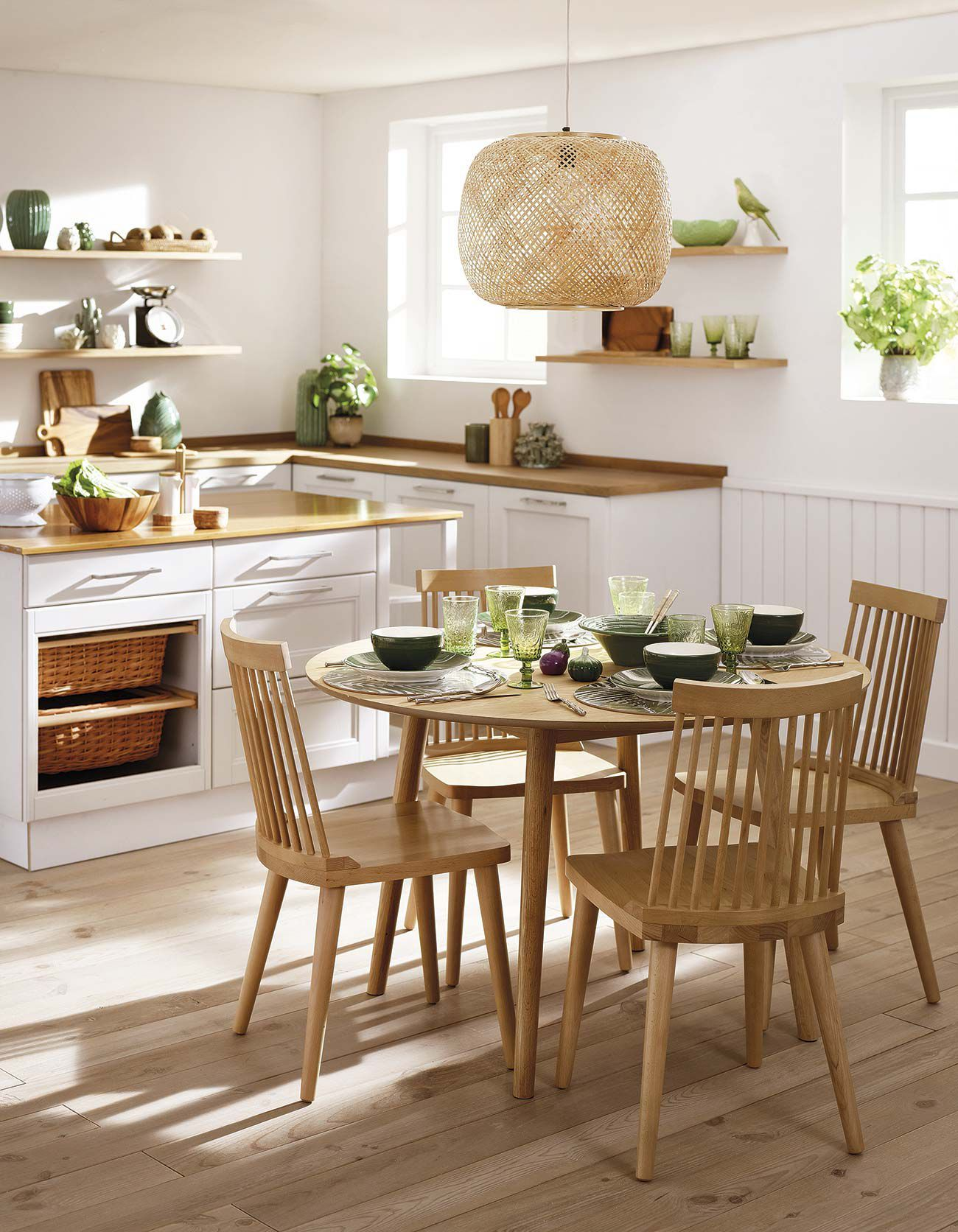 kitchen, wooden floor, white wall, white cabinet, wooden counter top, rattan top, wooden open shelves, wooden dining set